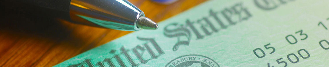 A tax check with a pen next to it